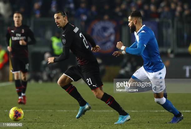 Zlatan Ibrahimovic of AC Milan is challenged by Jhon Chancellor of Brescia Calcio during the Serie A match between Brescia Calcio and AC Milan at...
