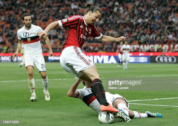 Zlatan Ibrahimovic of AC Milan is challenged by Kakha Kaladze of Genoa CFC during the Serie A match between AC Milan and Genoa CFC at Stadio Giuseppe...