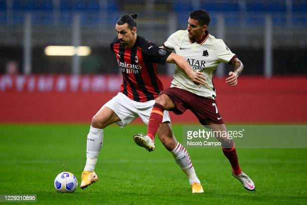 Zlatan Ibrahimovic of AC Milan is challenged by Lorenzo Pellegrini of AS Roma during the Serie A football match between AC Milan and AS Roma The...