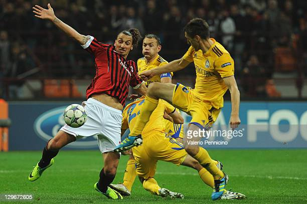 Zlatan Ibrahimovic of AC Milan is challenged by Marko Simic and Artyom Radkov of FC BATE Borisov during the UEFA Champions League group H match...