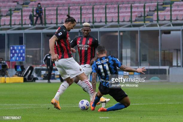Zlatan Ibrahimovic of AC Milan is fouled by Aleksandar Kolarov of Internazionale in the penalty area for AC Milan to be awarded a first half penalty...