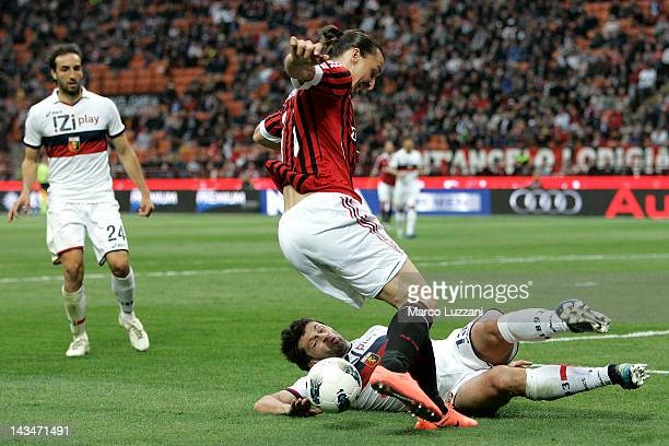 Zlatan Ibrahimovic of AC Milan is tackled by Kakha Kaladze of Genoa CFC during the Serie A match between AC Milan and Genoa CFC at Stadio Giuseppe...
