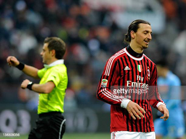 Zlatan Ibrahimovic of AC Milan reacts next to referee Nicola Rizzoli during the Serie A match between AC Milan and SSC Napoli at Stadio Giuseppe...