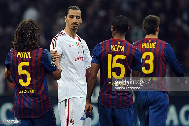 Zlatan Ibrahimovic of AC Milan salutes Carles Puyol of FC Barcelona at the end of the UEFA Champions League quarter final first leg match between AC...
