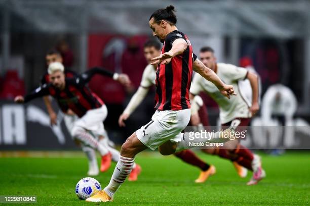 Zlatan Ibrahimovic of AC Milan scores a goal from a penalty kick during the Serie A football match between AC Milan and AS Roma The match ended 33 tie