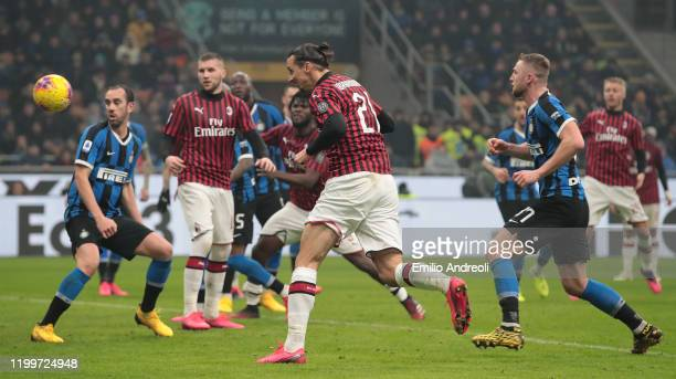 Zlatan Ibrahimovic of AC Milan scores his goal during the Serie A match between FC Internazionale and AC Milan at Stadio Giuseppe Meazza on February...