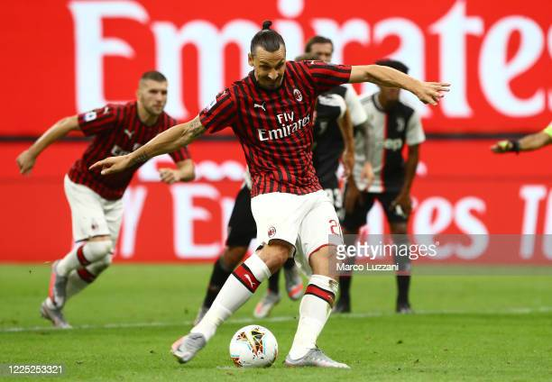 Zlatan Ibrahimovic of AC Milan scores his goal from the penalty spot during the Serie A match between AC Milan and Juventus at Stadio Giuseppe Meazza...