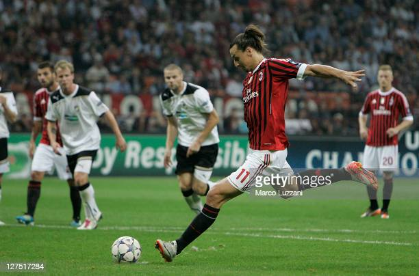 Zlatan Ibrahimovic of AC Milan scores his goal from the penalty spot during the UEFA Champions League group H match between AC Milan and FC Viktoria...