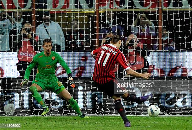 Zlatan Ibrahimovic of AC Milan scores his team's first goal from the penalty spot during the Serie A match between AC Milan and AS Roma at Stadio...