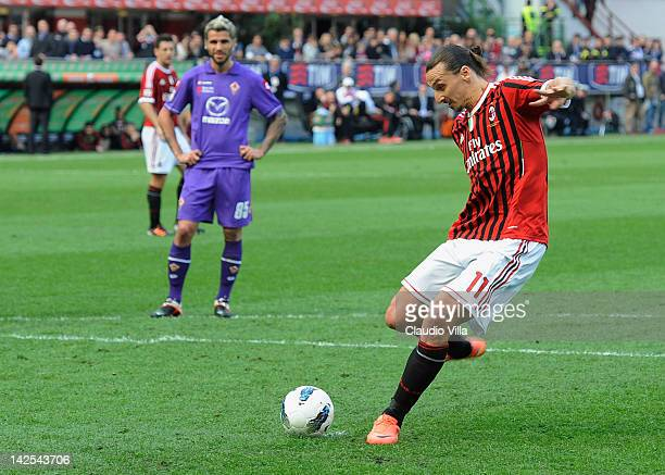 Zlatan Ibrahimovic of AC Milan scores the opening goal from the penalty spot during the Serie A match between AC Milan and ACF Fiorentina at Stadio...