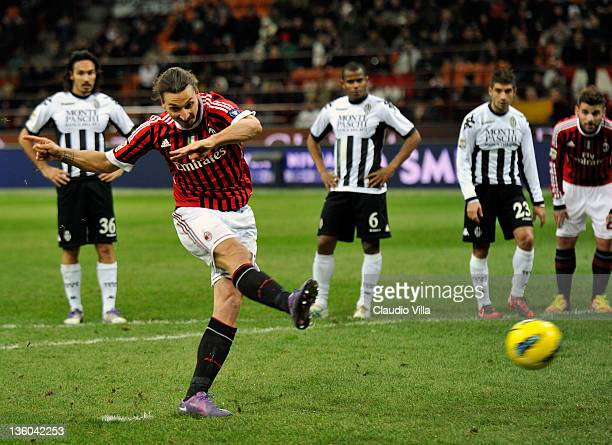 Zlatan Ibrahimovic of AC Milan scores the second goal during the Serie A match between AC Milan and AC Siena at Stadio Giuseppe Meazza on December...