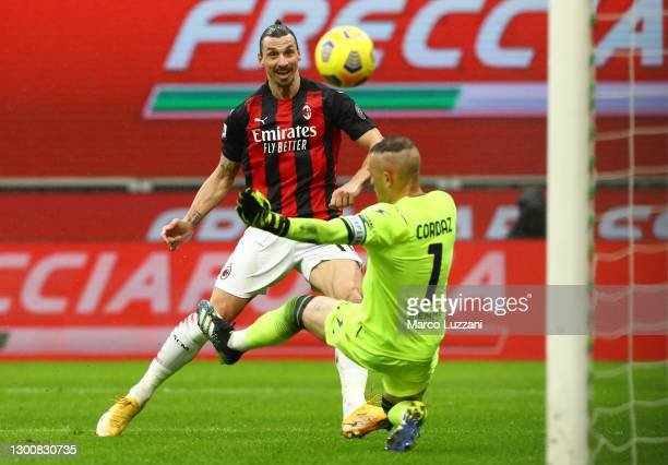 Zlatan Ibrahimovic of AC Milan scores their side's first goal past Alex Cordaz of Crotone during the Serie A match between AC Milan and FC Crotone at...