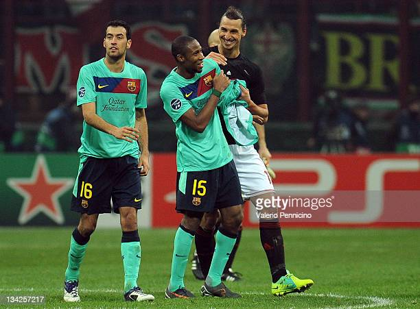 Zlatan Ibrahimovic of AC Milan smiles with Seydou Keita of FC Barcelona at the end of the UEFA Champions League group H match between AC Milan and FC...