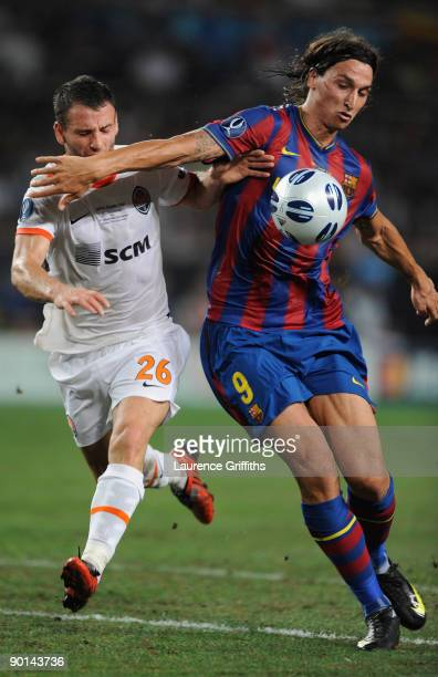 Zlatan Ibrahimovic of Barcelona battles with Razvan Rat of Shakhtar Donetsk during the UEFA Super Cup Final between FC Barcelona and Shakhtar Donetsk...