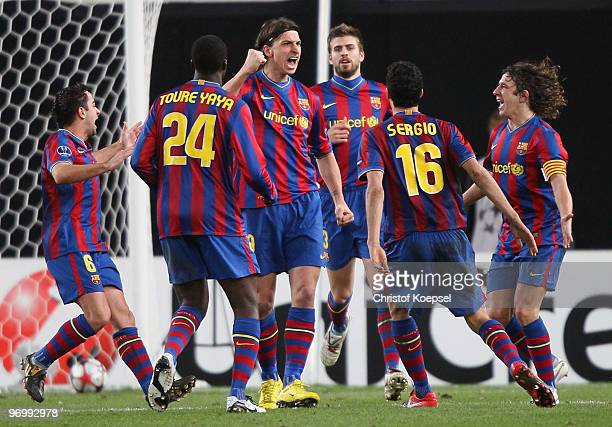 Zlatan Ibrahimovic of Barcelona celebrates scoring his team's first goal with team mates during the UEFA Champions League round of sixteen first leg...