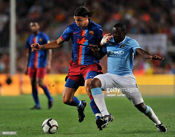 Zlatan Ibrahimovic of Barcelona duels for the ball with Nedum Onuoha of Manchester City during the Joan Gamper Trophy match between Barcelona and...