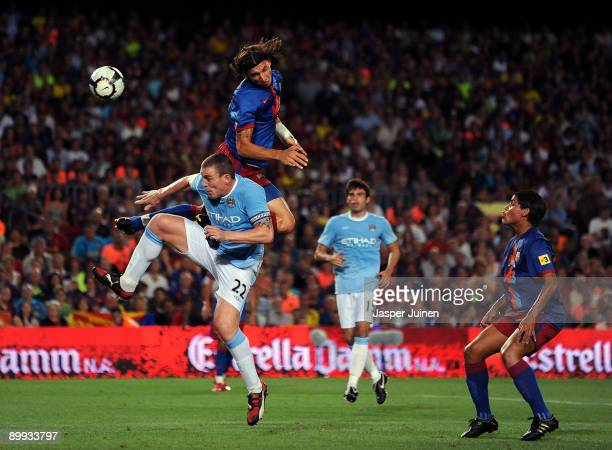 Zlatan Ibrahimovic of Barcelona duels in the air with Richard Dunne of Manchester City during the Joan Gamper Trophy match between Barcelona and...