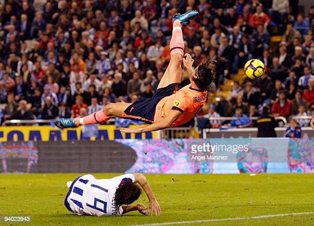 Zlatan Ibrahimovic of Barcelona jumps for a ball during the La Liga match between Deportivo La Coruna and Barcelona at the Riazor stadium on December...