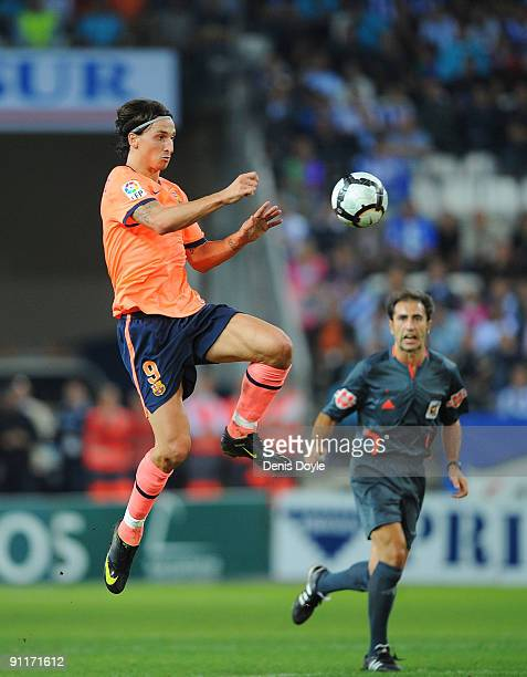 Zlatan Ibrahimovic of Barcelona lobs the ball over the Malaga defence during the La Liga match between Malaga and Barcelona at La Rosaleda Stadium on...