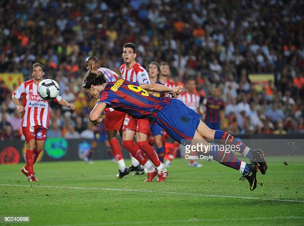 Zlatan Ibrahimovic of Barcelona scores his first goal for Barcelona during the La Liga match between Barcelona and Sporting Gijon at the Nou Camp...
