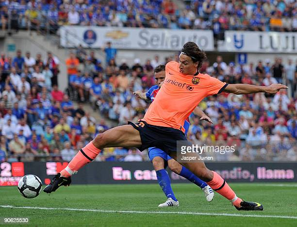 Zlatan Ibrahimovic of Barcelona scores his sides opening goal during the La Liga match between Getafe and Real Madrid at the Coliseum Alfonso Perez...