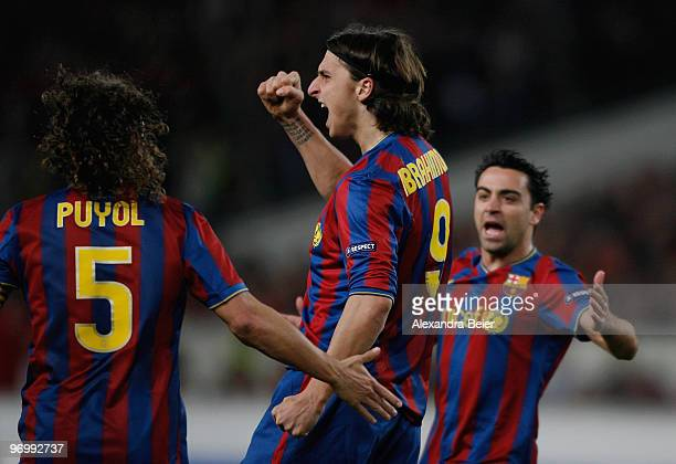 Zlatan Ibrahimovic of FC Barcelona celebrates his first goal with teammates Carles Puyol and Xavi Hernandez during the UEFA Champions League round of...