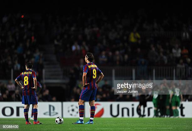 Zlatan Ibrahimovic of FC Barcelona stands with his teammate Andres Iniesta waiting to resume the game backdropped by FC Rubin Kazan players...