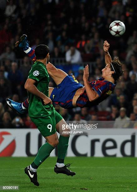 Zlatan Ibrahimovic of FC Barcelona tries to score with an overhaed kick past Lasha Salukvadze of FC Rubin Kazan during the UEFA Champions League...