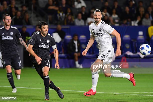 Zlatan Ibrahimovic of LA Galaxy and Michael Parkhurst of Atlanta United vie for the ball during the Major League Soccer match between Atlanta United...