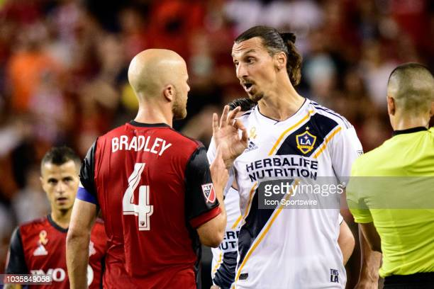Zlatan Ibrahimovic of LA Galaxy argues with Michael Bradley of Toronto FC during the MLS regular season match between Toronto FC and LA Galaxy on...