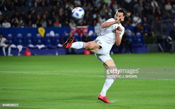 Zlatan Ibrahimovic of LA Galaxy attempts to stop the ball from Brad Guzan of Atlanta United during their Major League Soccer match in Carson...