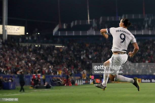 Zlatan Ibrahimovic of LA Galaxy celebrates after scoring a goal to make it 20 whilst wearing a shirt in the second half with his name spelt...