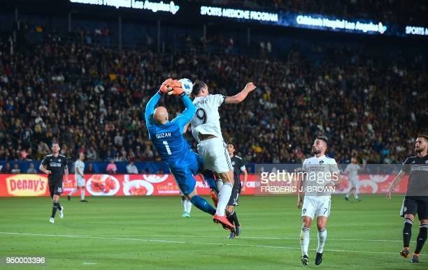 Zlatan Ibrahimovic of LA Galaxy challenges Brad Guzan of Atlanta United for the ball in their Major League Soccer match in Carson California on April...