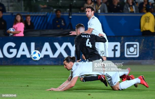 Zlatan Ibrahimovic of LA Galaxy collides with Greg Garza of Atlanta United in the penalty box to no avail during their Major League Soccer match in...