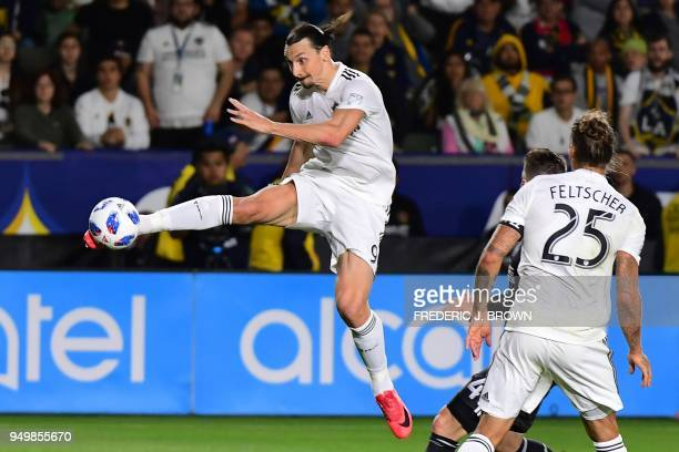 Zlatan Ibrahimovic of LA Galaxy crosses the ball in front of Greg Garza of Atlanta United during the Major League Soccer match between Atlanta United...
