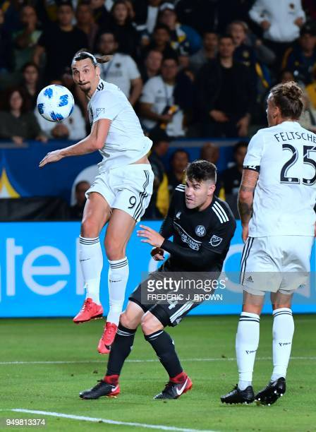 Zlatan Ibrahimovic of LA Galaxy crosses under pressure from Greg Garza of Atlanta United during their Major League Soccer match in Carson California...