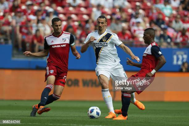 Zlatan Ibrahimovic of LA Galaxy fights for the ball with Carlos Gruezo of FC Dallas during the match between Dallas FC and LA Galaxy at Toyota...