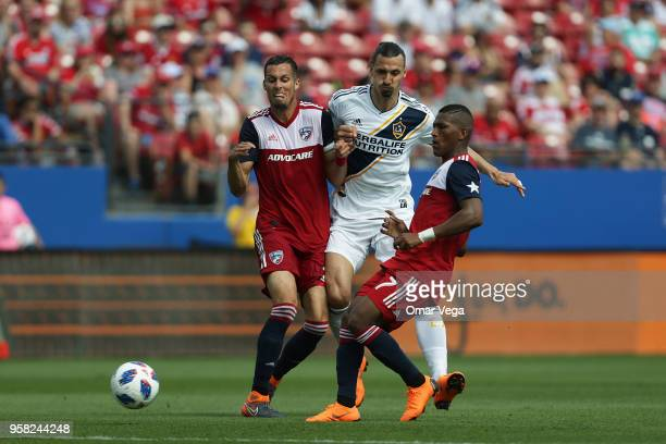 Zlatan Ibrahimovic of LA Galaxy fights for the ball with Carlos Gruezo of FC Dallas during the Major League Soccer match between Dallas FC and LA...