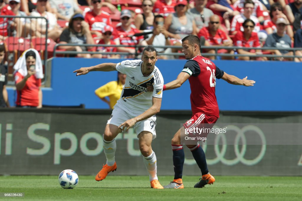 Zlatan Ibrahimovic of LA Galaxy fights for the ball with Matt Hedges of FC Dallas during the Major Soccer League match between Dallas FC and LA Galaxy at Toyota Stadium on May 12, 2018 in Frisco, Texas.