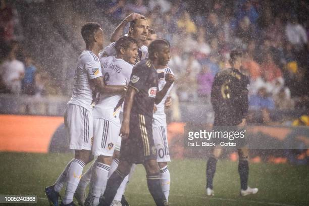 Zlatan Ibrahimovic of LA Galaxy gets congratulations from teammates after scoring a goal during the Major League Soccer match between LA Galaxy and...