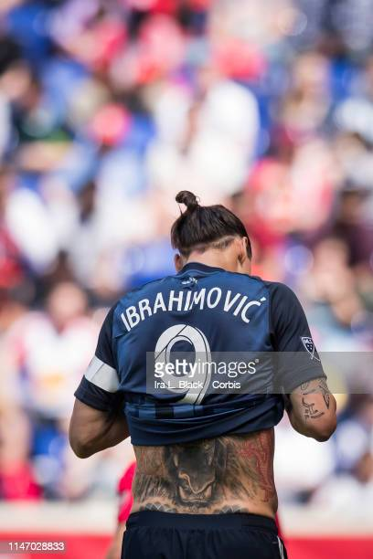Zlatan Ibrahimovic of LA Galaxy pulls up his shirt and has his tattoo exposed during warm ups of the MLS match between LA Galaxy and New York Red...