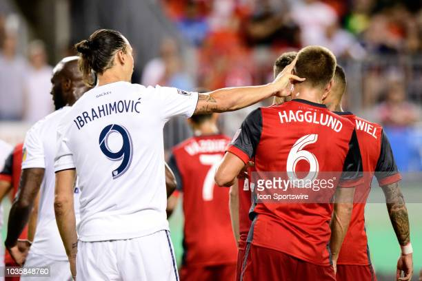 Zlatan Ibrahimovic of LA Galaxy pushes Nick Hagglund of Toronto FC during the MLS regular season match between Toronto FC and LA Galaxy on September...