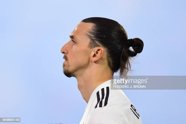 Zlatan Ibrahimovic of LA Galaxy takes in the national anthem before the Major League Soccer match between Atlanta United and LA Galaxy in Carson...