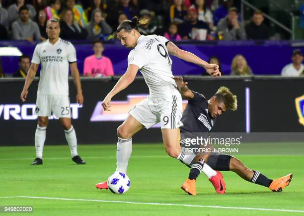 Zlatan Ibrahimovic of LA Galaxy vies for the ball with Josef Martinez of Atlanta United during their Major League Soccer match in Carson California...