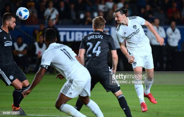 Zlatan Ibrahimovic of LA Galaxy vies for the ball with Julian Gressel and Leandro Pirez of Atlanta United during their Major League Soccer match in...