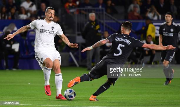 Zlatan Ibrahimovic of LA Galaxy vies for the ball with Leandro Pirez of Atlanta United during the Major League Soccer match between Atlanta United...