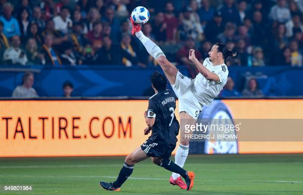 TOPSHOT Zlatan Ibrahimovic of LA Galaxy vies for the ball with Michael Parkhurts of Atlanta United during their Major League Soccer match in Carson...