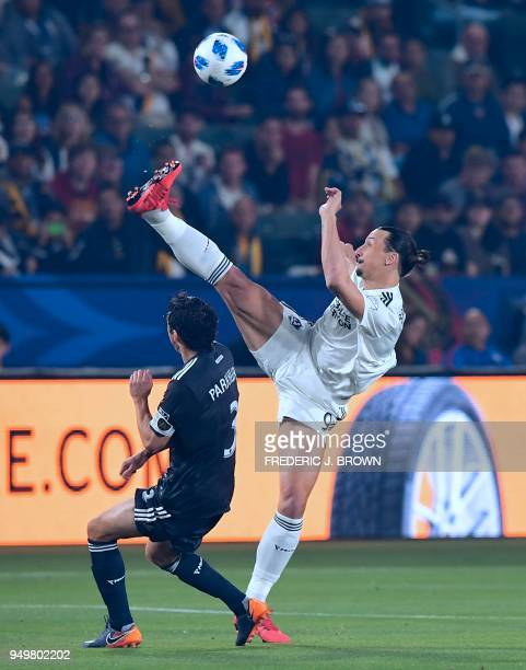 Zlatan Ibrahimovic of LA Galaxy vies for the ball with Michael Parkhurts of Atlanta United during their Major League Soccer match in Carson...