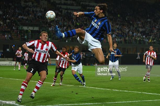 Zlatan Ibrahimovic of Inter leaps towards the ball ahead of Jan Kromkamp of PSV during the UEFA Champions League Group G match between Inter Milan...
