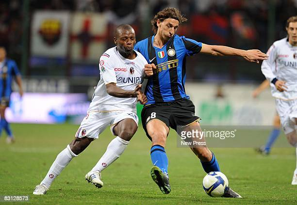 Zlatan Ibrahimovic of Inter Milan and Gaby Mudingayi of Bologna during the Serie A match between FC Inter Milan and Bologna FC at the Stadio Meaazza...